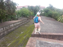 Heather - Mid-Air Jump as we walk along the walls of Intramuros