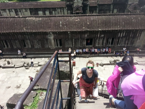 Climbing up to the main temple of Angkor Watt
