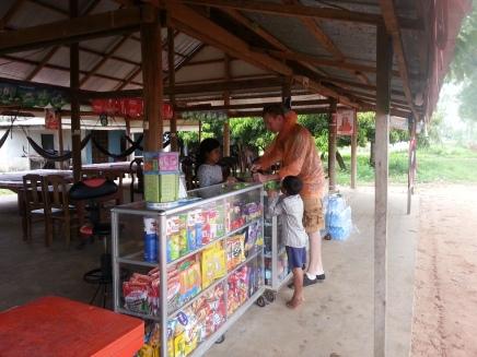 Buying roadside snacks - these kids took their cookies!