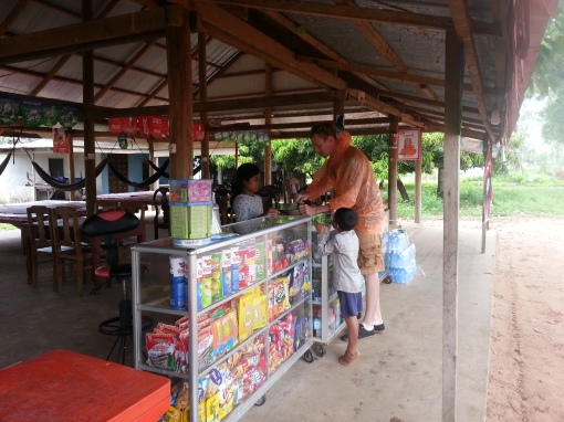 Buying roadside snacks - these kids took their cookies!
