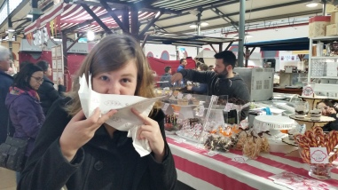 eating a crepe and getting icing sugar everywhere
