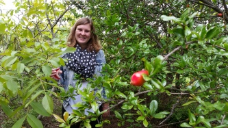 me with a Pomegranate tree at Kevin's Avo Maria's house