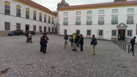tourists taking photos of local students on a field trip