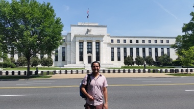 Kevin in front of the Federal Reserve