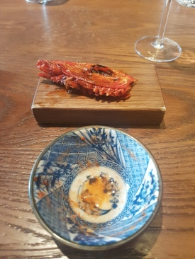 We squeezed the juices of the prawn head into the bowl, and then ate it. Messy and kinda weird but delicious!