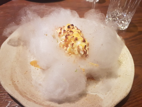 """Corn"" - so much more than its name. This is ice cream, rolled in corn flavoured marshmallow, on a bed of cotton candy"