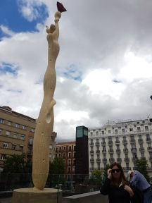 Beside a statue outside of the Reina Sofia.