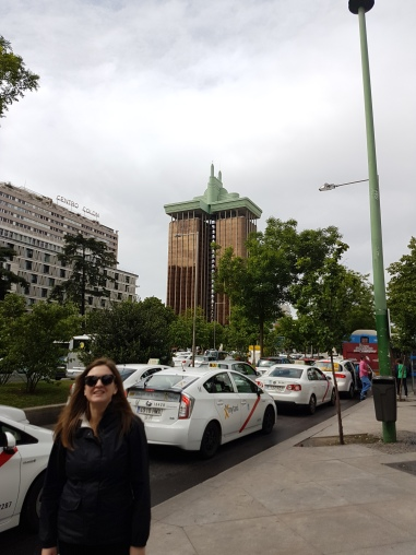 "Behind me is a famous Spanish building, often featured on lists of ""ugliest buildings"""
