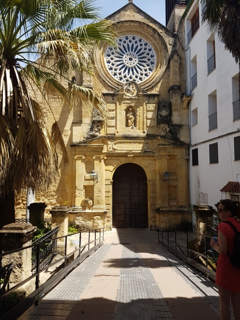a beautiful church in a small courtyard