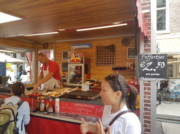 This vendor has been in the market for generations, making traditional poffertjes