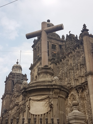 When the Spanish colonizers came to Mexico City they had locals build their churches. And often locals worked their own traditional arts (like the snakes on this cross) into the final product