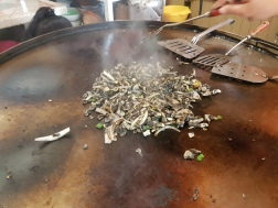 And here's Evelyn cooking the huitlacoche for us