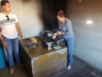 Here's Daniel's mom, showing us how to make our own corn meal by hand